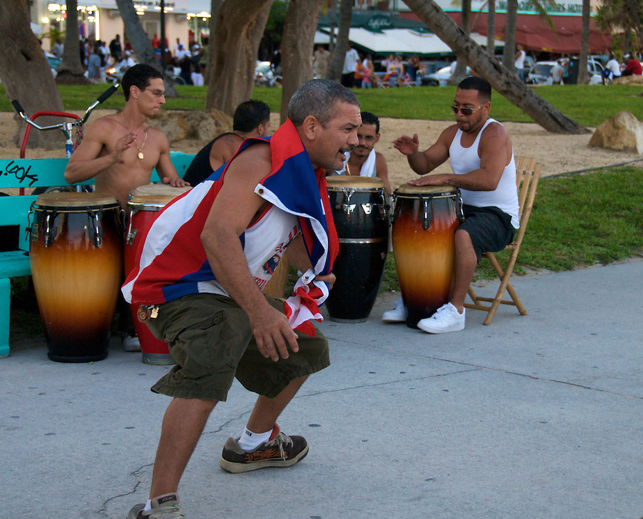 Group of Cubans performing and dancing in the street on Ocean Drive on the Miami Beach Urban Weekend 2008.The Miami Beach Urban weekend in the largest Urban Festival in the World, that caters toward the Hip Hop Generation. Over 300.000 participants make the annual trek to South Beach for 4 days full of fun, food, festivities, entertainment, music, and more.