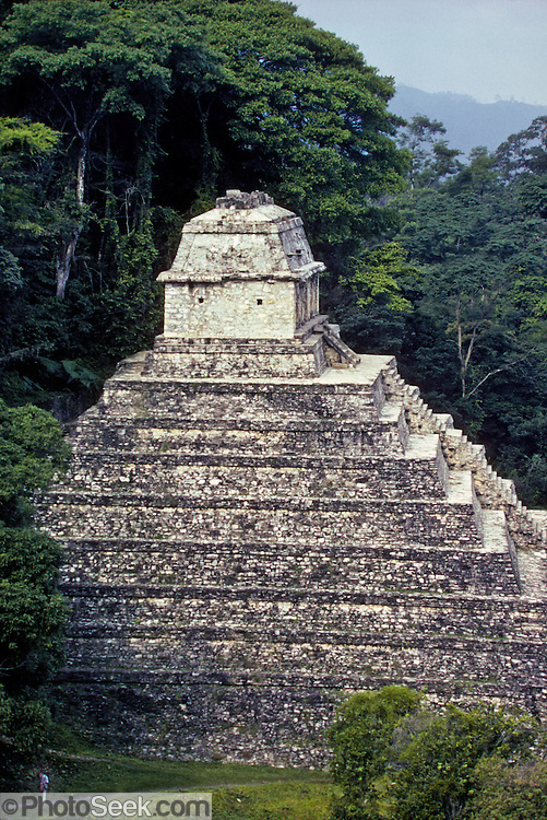 "At Palenque, Mexico, the Temple of the Inscriptions is the burial shrine of Maya leader Pacal the Great (615-683 AD). The name ""Pacal"" means ""shield"" in the Maya language. Published in Wilderness Travel 1987 Catalog of Adventures."