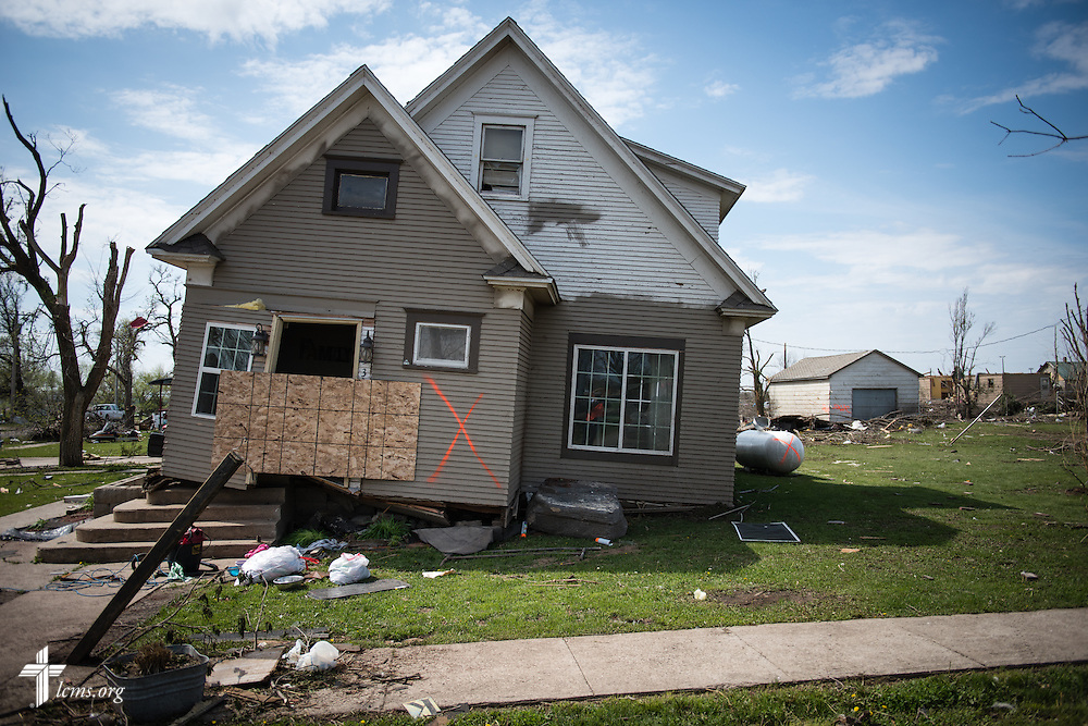 A house moved off its foundation sits vacant on Tuesday, May 12, 2015, in Delmont, S.D. A tornado swept through the area on Sunday and destroyed nearby Zion Lutheran Church and surrounding buildings. LCMS Communications/Erik M. Lunsford