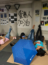 Pedestrian underpass at Central used by foreign domestic helpers on their day-off is also a Lennon Wall used by Pro-democracy supporters to spray graffiti,post notes, posters and other artwork in support of pro-democracy movement in Hong Kong.