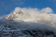 A winter storm envelops the summit of Mount Isolation, a 1,620-meter (5,315-foot) peak in Fiordland National Park, New Zealand. Located on the southwestern portion of the South Island, Fiordland National Park is New Zealand's largest national park.