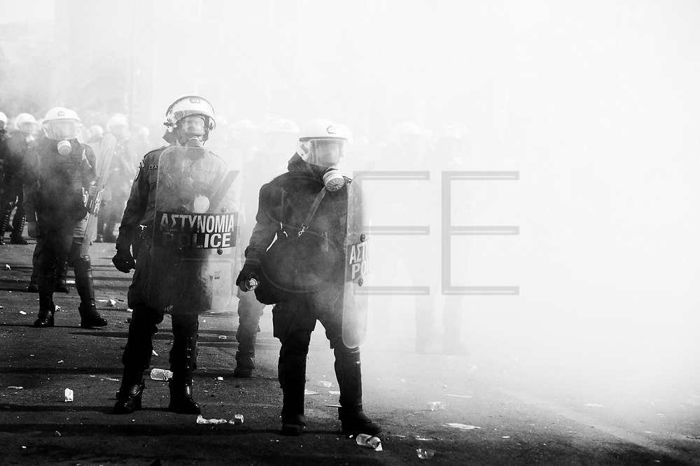Athens, greece - Riot police standing amid tear gas near the Parliament. Greek economical crisis started in 2008. The so-called Austerity measures imposed to the country by the &ldquo;Troika&rdquo; (European Union, European Central Bank, and International Monetary Fund) to reduce its debt, were followed by a deep recession and the worsening of life conditions for millions of people. Unemployment rate grew from 8.5% in 2008 to 25% in 2012 (source: Hellenic Statistical Authority). <br /> Bruno Sim&otilde;es Castanheira