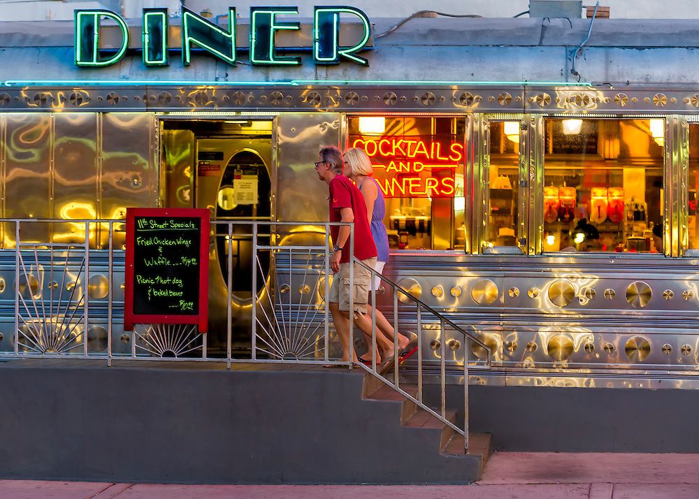 Miami Beach - Circa 2012: Couple walking into a retro diner in Miami Beach. Editorial Usage Only.