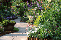 curving path through well planted garden