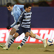 Benny Feilhaber, (right), Sporting KC, is challenged by Andrew Jacobson, NYCFC, during the New York City FC Vs Sporting Kansas City, MSL regular season football match at Yankee Stadium, The Bronx, New York,  USA. 27th March 2015. Photo Tim Clayton