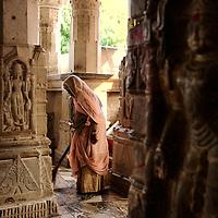 Women brooming the interior of the Jagdish Mandir temple