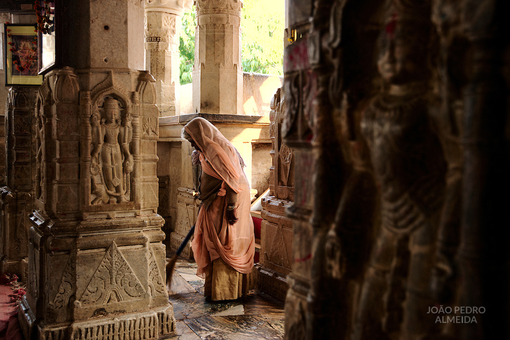 Women brooming the interior of the Jagdish Mandir temple
