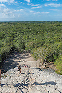 View from the top of the Ancient Pyramid at the Mayan archeological site of Coba, which is still open to the public to climb its approximately 130 narrow steps.
