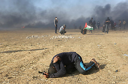 Palestinian protester suffering from teargas inhalation during clashes with Israeli soldiers at the border fence with Israel east of Khan Yunis in the southern Gaza Strip, Israeli soldiers killed at least 60 Palestinians and wounded more than 2,700. as demonstrations on the Gaza-Israel border coincided with the controversial opening of the U.S. Embassy in Jerusalem. This marks the deadliest day of violence in Gaza since 2014. Gaza's Hamas rulers have vowed that the marches will continue until the decade-old Israeli blockade of the territory is lifted. Gaza Strip, Palestine, May 15, 2018. Photo by Ashraf Amra/SalamPix/ABACAPRESS.COM