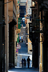 MALTA VALETTA 23JUL06 - Narrow alleyways in Valetta's grid of streets designed by Jean Parisot de la Valette. Valetta was built by the Knights of the Order of St. John in the 16th and 17th centuries - to this date the city is the seat of the Maltese government and the most important museums. UNESCO has declared Valetta a World Heritage site, describing it as 'one of the most concentrated historic areas of the world.'. . jre/Photo by Jiri Rezac. . © Jiri Rezac 2006. . Contact: +44 (0) 7050 110 417. Mobile:  +44 (0) 7801 337 683. Office:  +44 (0) 20 8968 9635. . Email:   jiri@jirirezac.com. Web:    www.jirirezac.com