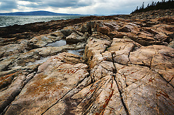 Just a few miles across the bay, as the crow flies, from Acadia National Park's Mt. Desert Island lies the Schoodic Peninsula. With a rugged and rocky shoreline mostly composed of granite there can also be found several ancient volcanic dikes. The black striations formed long ago after magma pushed it's way up to the surface through cracks in the older granite and cooled.