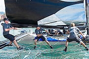 Emirates Team New Zealand sailors Peter Burling, Glenn Ashby and Edwin De Laat raise the main for the Extreme Sailing Series Practice day in Nice. 1/10/2014
