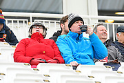 A spectators wrapped up warm they await the start of play during the first day of the Specsavers County Champ Div 1 match between Hampshire County Cricket Club and Essex County Cricket Club at the Ageas Bowl, Southampton, United Kingdom on 5 April 2019.