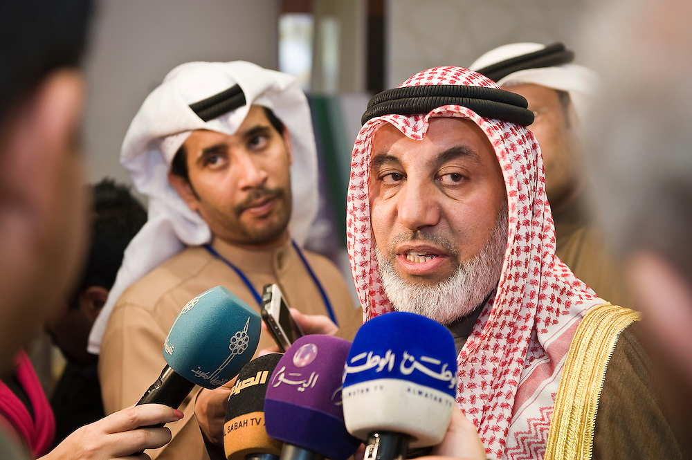 Kuwait Oil Minister Muhammed Al-Busairi talks to reporters during a tour of the elections media center in Kuwait City on Jan. 25. More than 400,000 Kuwaiti men and women are eligible to vote in the Feb. 2, 2012 parliamentary elections  to elect a new 50-member National Assembly (parliament). Approximately 320 candidates are in the running currently in the polls.