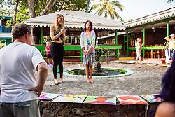 Laquelle Mari, left, and Charmaine Olivia, peruse the finished works by students at Tillett Garden.  Charmaine Olivia Oil Painting Workshop at Art Explorium.  24 May 2015.  © Aisha-Zakiya Boyd