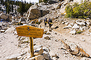 Backpackers and sign on the Mount Whitney Trail, John Muir Wilderness, California USA