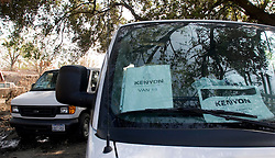 30 Sept, 2005.  New Orleans, Louisiana. Lower 9th ward. Hurricane Katrina aftermath.<br /> The remnants of the lives of ordinary folks, now covered in mud as the flood waters remain. Private Contractor Kenyon, worldwide disaster management corporation parks sterile mortician vans ready for body collection. Kenyon has won the body removal contract.<br /> Photo; ©Charlie Varley/varleypix.com