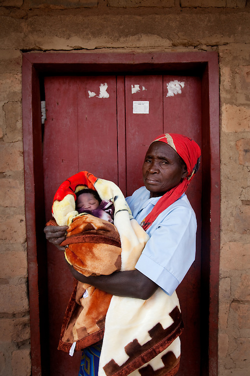 The home of Mutinta Hayumba who has just given birth to her second baby daughter a few hours before, Singonya, Monze district, Zambia.