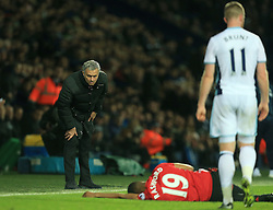 17 December 2016 - Premier League - West Bromwich Albion v Manchester United - Manchester United manager Jose Mourniho checks on Marcus Rashford of Manchester United after a shoulder barge by Chris Brunt of West Bromwich Albion - Photo: Paul Roberts / Offside.