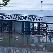 A man walks in flooded waters as the Susquehanna river rises around the American Legion property, Thursday, Sept. 8, 2011 in Havre De Grace, Md.<br /> <br /> Flooding from the remnants of Tropical Storm Lee drove hundreds of Maryland residents from their homes Thursday and claimed at least one life less than two weeks after Hurricane Irene soaked the national capital region. (AP Photo, Saquan Stimpson)