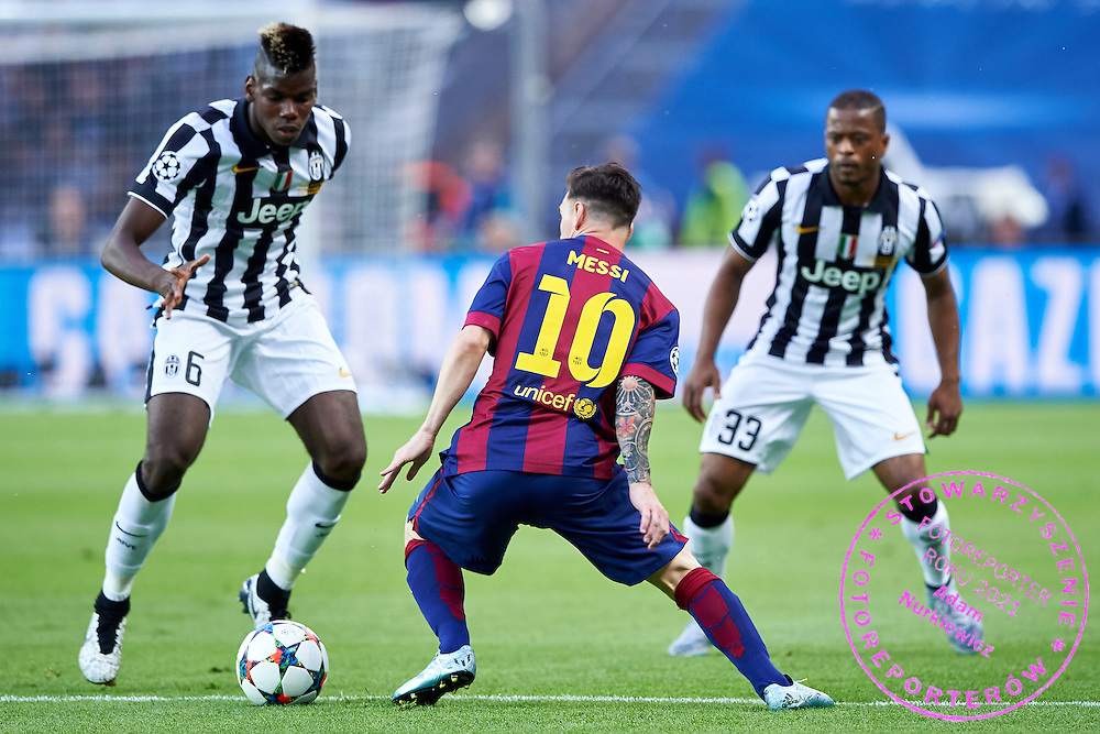 (C) Lionel Messi of FC Barcelona fights for the ball with (L) Paul Pogba and (R) Patrice Evra both from Juventus during the 2014/15 UEFA Champions League Final between Juventus and FC Barcelona at Olympiastadion on June 6, 2015 in Berlin, Germany.<br /> Germany, Berlin, June 6, 2015<br /> <br /> Picture also available in RAW (NEF) or TIFF format on special request.<br /> <br /> For editorial use only. Any commercial or promotional use requires permission.<br /> <br /> Adam Nurkiewicz declares that he has no rights to the image of people at the photographs of his authorship.<br /> <br /> Mandatory credit:<br /> Photo by &copy; Adam Nurkiewicz / Mediasport