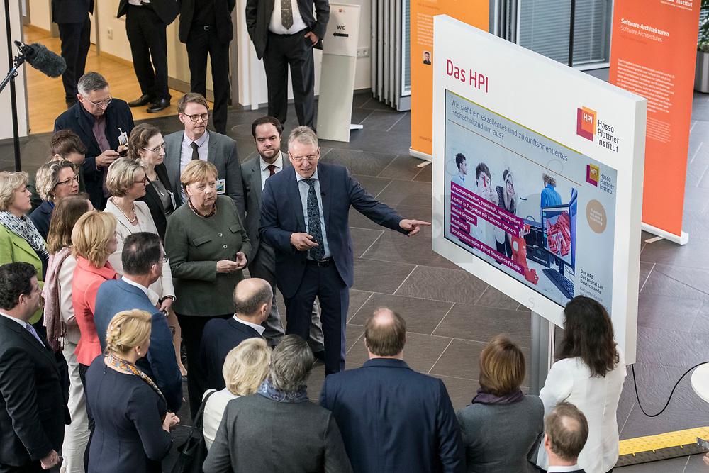 14 NOV 2018, POTSDAM/GERMANY:<br /> Angela Merkel (Mi-L), CDU, Bundeskanzlerin, und Prof. Christoph Meinel (Mi-R), Leiter des HPI, waehrend einer Praesentation des HPI im Rahmen der Klausurtagung des Bundeskabinetts, Hasso Plattner Institut (HPI), Potsdam-Babelsberg<br /> IMAGE: 20181114-01-056<br /> KEYWORDS; Kabinett, Klausur, Tagung