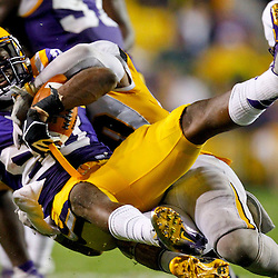 September 29, 2012; Baton Rouge, LA, USA; LSU Tigers wide receiver Jarvis Landry (80) is tackled by Towson Tigers safety Jordan Dangerfield (20) during the fourth quarter on a kickoff return during a game at Tiger Stadium. LSU defeated Towson 38-22. Mandatory Credit: Derick E. Hingle-US PRESSWIRE