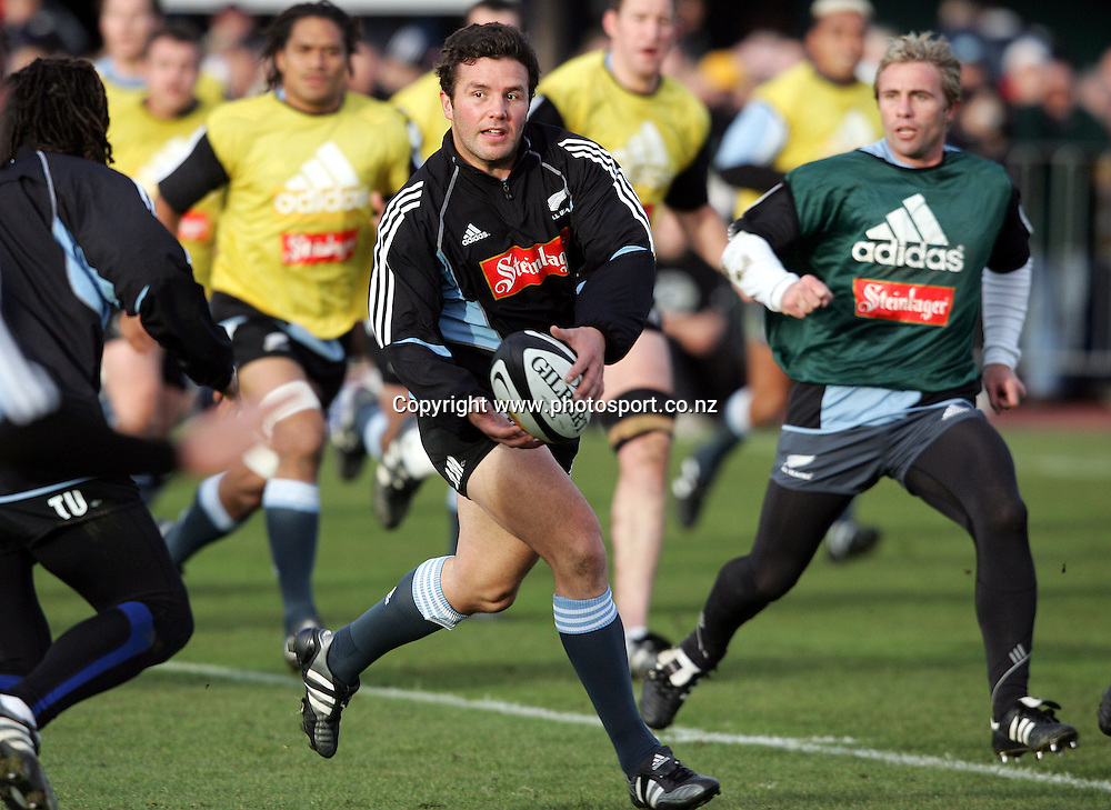 All Black centre Aaron Mauger looks to pass during a training session held at QE II Park, Christchurch, New Zealand, on Monday 20 June, 2005. Photo: PHOTOSPORT<br /><br /><br />127894