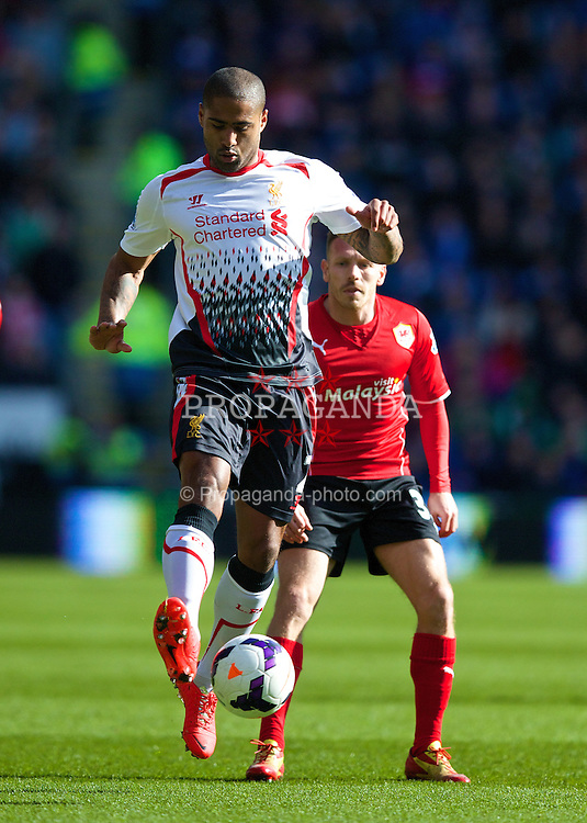 CARDIFF, WALES - Saturday, March 22, 2014: Liverpool's Glen Johnson in action against Cardiff City during the Premiership match at the Cardiff City Stadium. (Pic by David Rawcliffe/Propaganda)