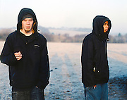 Chris and Kevin in a field, UK, 2000s.