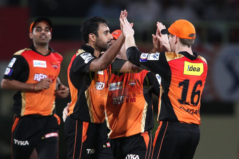 Ravi Bopara of Sunrisers Hyderabad is congratulated by Eoin Morgan of Sunrisers Hyderabad for getting Karun Nair of Rajasthan Royals wicket during match 11 of the Pepsi IPL 2015 (Indian Premier League) between The Sunrisers Hyderabad and The Rajasthan Royals held at the ACA-VDCA Stadium in Visakhapatnam India on the 16th April 2015.<br /> <br /> Photo by:  Shaun Roy / SPORTZPICS / IPL