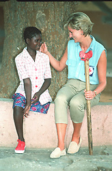 "Embargoed to 0001 Monday August 21 File photo dated 14/01/97 of Diana, Princess of Wales, with Sandra Tigica 13, at the orthopaedic workshop in Neves Mendinha, near Launda, Angola. Diana, Princess of Wales was a woman whose warmth, compassion and empathy for those she met earned her the description the ""people's princess""."