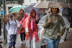 © licensed to London News Pictures. London, UK 09/09/2013. People walking under the rain in central London on Monday, September 9, 2013. Photo credit: Tolga Akmen/LNP