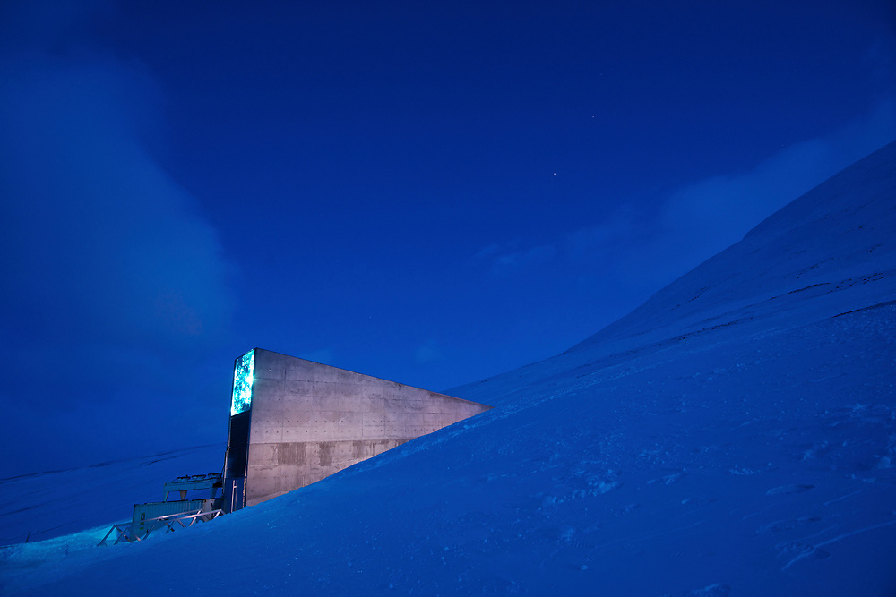 """Carey Fowler at the """"Doomsday"""" seed bank in Longyearbyen, Svalbard, Norway.  Dug into the frozen mountainside above the town, the seedbank is a last chance repository for millions of seeds, that could be used to restore agriculture should a disaster wipe out many of the plants we depend upon for food."""