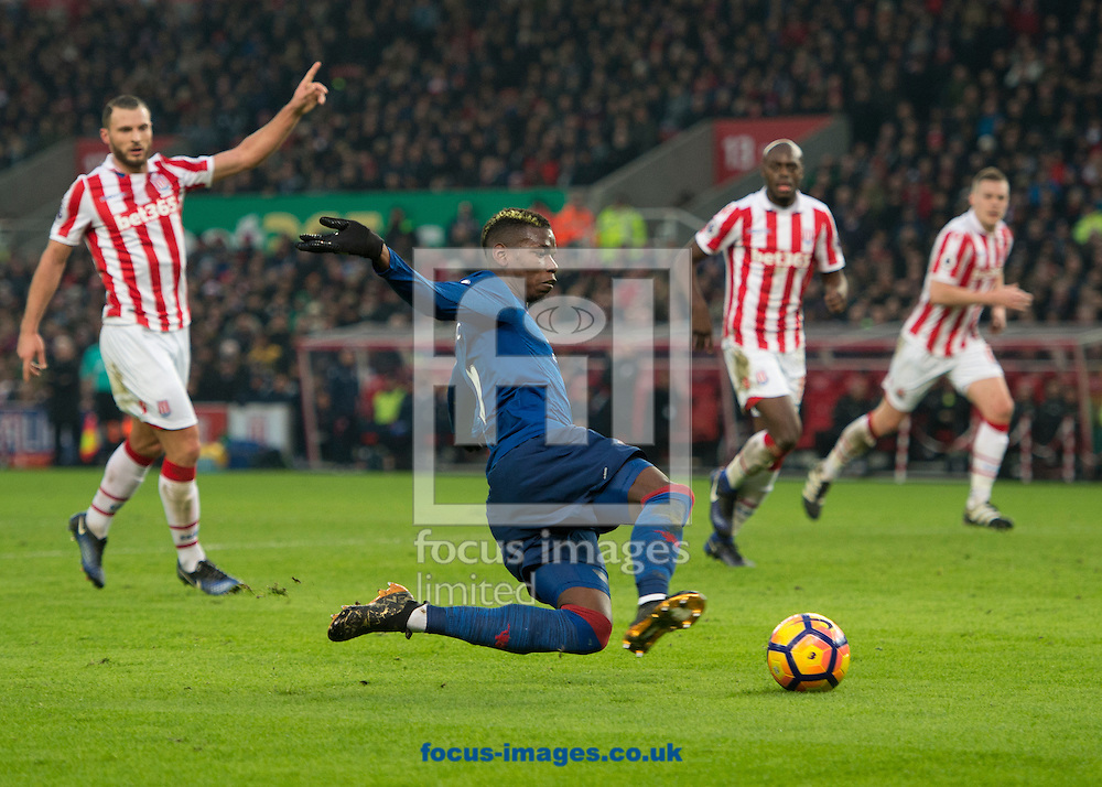 Paul Pogba of Manchester United shoots at goal during the Premier League match at the Bet 365 Stadium, Stoke-on-Trent<br /> Picture by Russell Hart/Focus Images Ltd 07791 688 420<br /> 21/01/2017