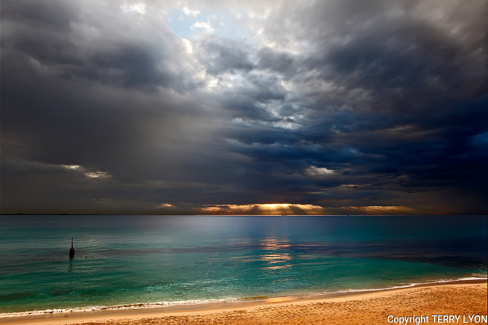 On a hot April afternoon it rains on Cottesloe beach as what looks like a Tropical Storm approaches with amazing light and clouds lighting up the sand and water.