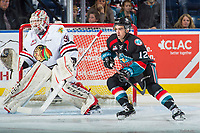 KELOWNA, CANADA - OCTOBER 20: Erik Gardiner #12 of the Kelowna Rockets looks for the pass in front of Cole Kehler #31 of the Portland Winterhawks on October 20, 2017 at Prospera Place in Kelowna, British Columbia, Canada.  (Photo by Marissa Baecker/Shoot the Breeze)  *** Local Caption ***