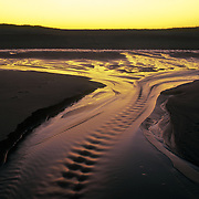Outgoing tide with sunset reflection at the Parker River National Wildlife Refuge, Newbury, Massachusetts, on Plum Island.