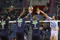 December 16, 2017 - Krakow, Poland - Maxim Mikhaylov  (18) of VC Zenit Kazan in action against Rodrigo Alemao (2), Isac Santos  (12) and Yoandy Leal (9)  of  Sada Cruzeiro Volei  during the match between Sada Cruzeiro Volei and VC Zenit kazan during the semi finals of Volleyball Men's Club World Championship 2017 in Tauron Arena, Krakow. (Credit Image: © Omar Marques/SOPA via ZUMA Wire)