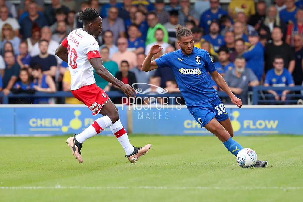 AFC Wimbledon defender Nesta Guinness-Walker (18) battles for possession with Rotherham United defender Michael Ihiekwe (20) during the EFL Sky Bet League 1 match between AFC Wimbledon and Rotherham United at the Cherry Red Records Stadium, Kingston, England on 3 August 2019.