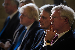 © Licensed to London News Pictures. 18/05/2017. Halifax, UK.  Foreign secretary BORIS JOHNSON, Chancellor PHILIP HAMMOND and Brexit Secretary DAVID DAVIS  watch the launch event for the Conservative Party manifesto at The Arches in Halifax, West Yorkshire. The Conservatives are the last of the three main parties to launch their manifesto ahead of a snap general election called for June 8, 2017. Photo credit: Ben Cawthra/LNP