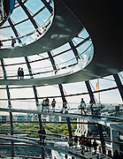 Dome of the Reichstag designed by Norman Foster is a gleaming metal and glass structure with an internal ramp that spirals up a to a terrace with 360-degree views of central Berlin. The dome overlooks the debating chamber for the Bundestag.<br /> Platz der Republik 1<br /> Berlin<br /> Germany