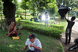 Burmese Top model An Sayn poses for a photographer in Maha Bandoola Garden in Yangon, Myanmar, Monday, May 6, 2013. After the last election Myanmar is changing rapidly because foreign investment, the country is falling on globalization, using mobile phones, internet, buying cars and motorcycles, wearing the same clothes than western countries, there is a lot of hotel even some of them 5 stars with astronomic prices but also most of the people still been poor, without drinking water in their houses or health care.