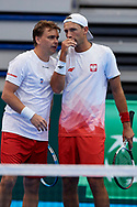 Sopot, Poland - 2018 April 08: (L) Marcin Matkowski and (R) Lukasz Kubot both from Poland talk eachother while Men's Double Match Nr 3 during Poland v Zimbabwe Tie Group 2, Europe/Africa Second Round of Davis Cup by BNP Paribas at 100 years of Sopot Hall on April 08, 2018 in Sopot, Poland.<br /> <br /> Mandatory credit:<br /> Photo by © Adam Nurkiewicz / Mediasport<br /> <br /> Adam Nurkiewicz declares that he has no rights to the image of people at the photographs of his authorship.<br /> <br /> Picture also available in RAW (NEF) or TIFF format on special request.<br /> <br /> Any editorial, commercial or promotional use requires written permission from the author of image.