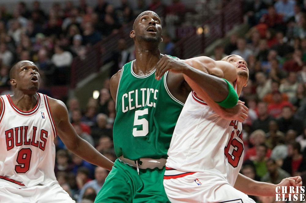 12 December 2009: Boston Celtics forward Kevin Garnett fights for the rebound against Chicago Bulls center Joakim Noah and Chicago Bulls forward Luol Deng during the Boston Celtics 106-80 win over the Chicago Bulls at the United Center, in Chicago, Illinois, USA.