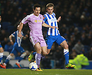 Reading striker Yann Kermorgant & Brighton striker James Wilson tussle for possession during the Sky Bet Championship match between Brighton and Hove Albion and Reading at the American Express Community Stadium, Brighton and Hove, England on 15 March 2016. Photo by Bennett Dean.