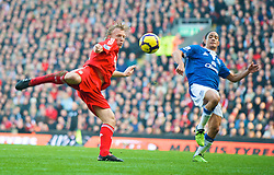 LIVERPOOL, ENGLAND - Saturday, February 6, 2010: Liverpool's Dirk Kuyt and Everton's Steven Pienaar during the Premiership match at Anfield. The 213th Merseyside Derby. (Photo by: David Rawcliffe/Propaganda)