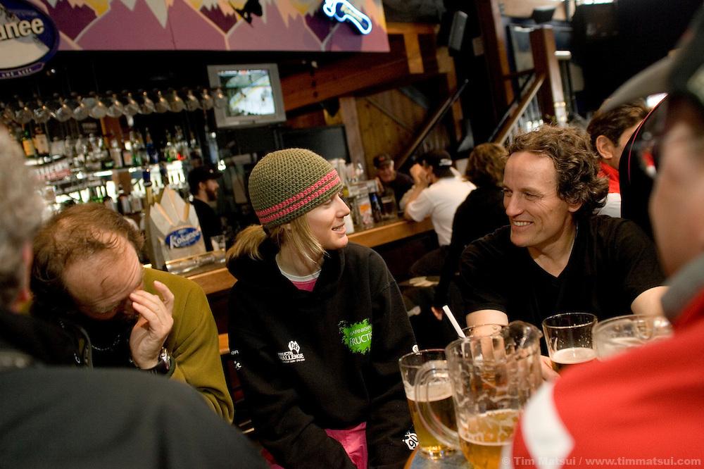 Ski instructors have an apres ski beer at Merlin, a bar at Whistler-Blackcomb ski resort in British Columbia, Canada.