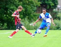 Bristol Rovers' U18s  Chad Douglas closes down his opponent  - Photo mandatory by-line: Dougie Allward/JMP - Tel: Mobile: 07966 386802 17/08/2013 - SPORT - FOOTBALL - Bristol Rovers Training Ground - Friends Life Sports Ground - Bristol - Academy - Under 18s - Youth - Bristol Rovers U18s V Bournemouth U18s