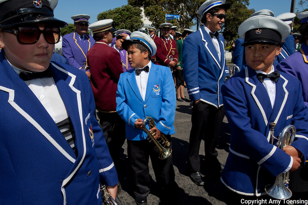 RATANA, NEW ZEALAND -- JANUARY 24: The Ratana Church Marching band leads various speakers and visitors between the Ratana Marae and the church for services during the annual birthday celebrations for the founder, Tahupotiki Wiremu Ratana. ..From Wikipedia:.The Ratana movement is a M?ori religion and pan-tribal political movement founded by Tahupotiki Wiremu Ratana in early 20th century New Zealand. The Ratana Church has its headquarters at the settlement of Ratana, near Wanganui...In 1918, Tahupotiki Wiremu Ratana saw a vision, which he regarded as divinely inspired, asking him to preach the gospel to the M?ori people, to destroy the power of the tohunga and to cure the spirits and bodies of his people. Until 1924, he preached to increasingly large numbers of M?ori, and T.W. Ratana established a name for himself as the &quot;M?ori Miracle Man&quot;. Initially, the movement was seen as a Christian revival but it soon moved away from mainstream churches. On 31 May 1925, Te Haahi Ratana (The Ratana Church) was formally established as a separate church, with its founder acknowledged as Te Mangai or the mouthpiece of God...Contact: ..Wiremu Meremere, Church Secretary.haahiratana@nettel.net.nz..Photo By Amy Toensing _________________________________<br />